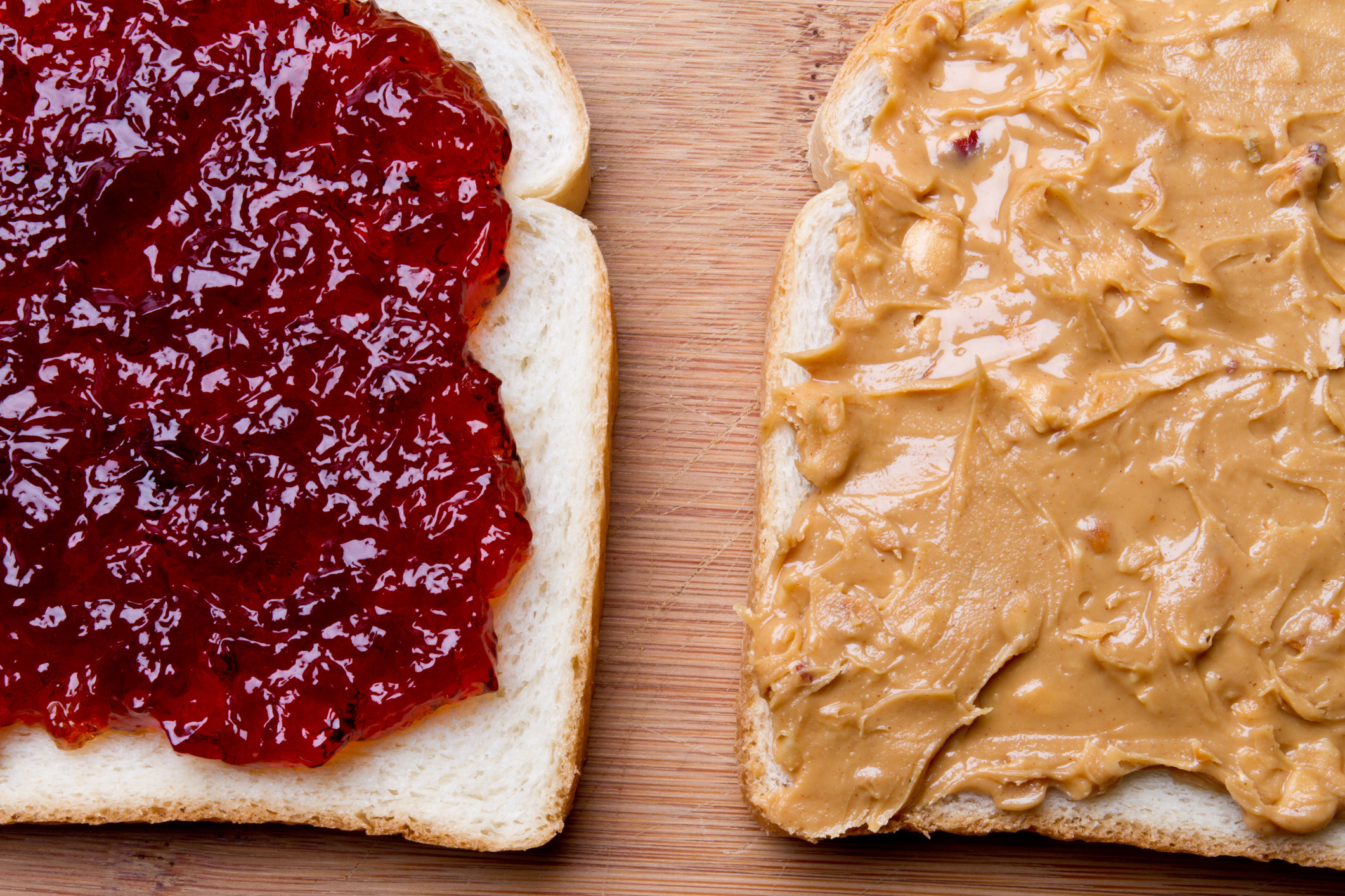 Peanut butter and jelly spread on bread