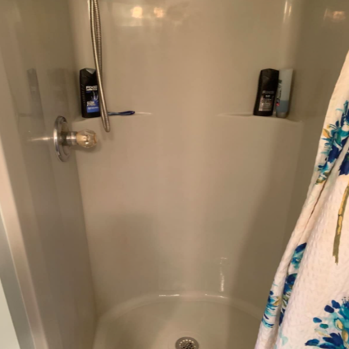 Reviewer's after of totally clean shower wall
