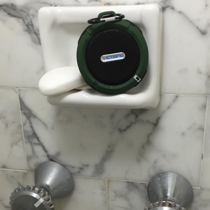 A customer review photo of their speaker in the shower