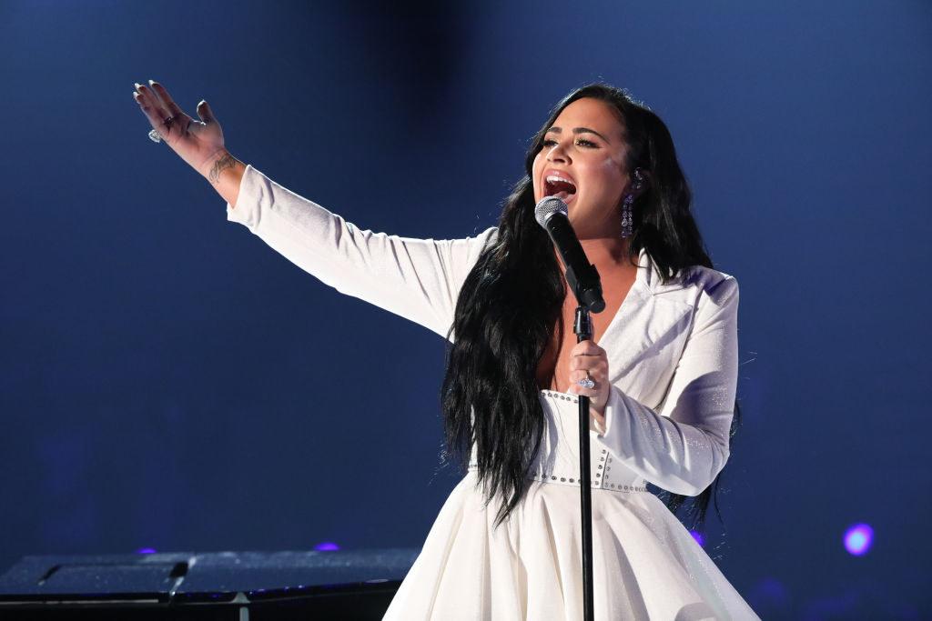 Demi singing onstage