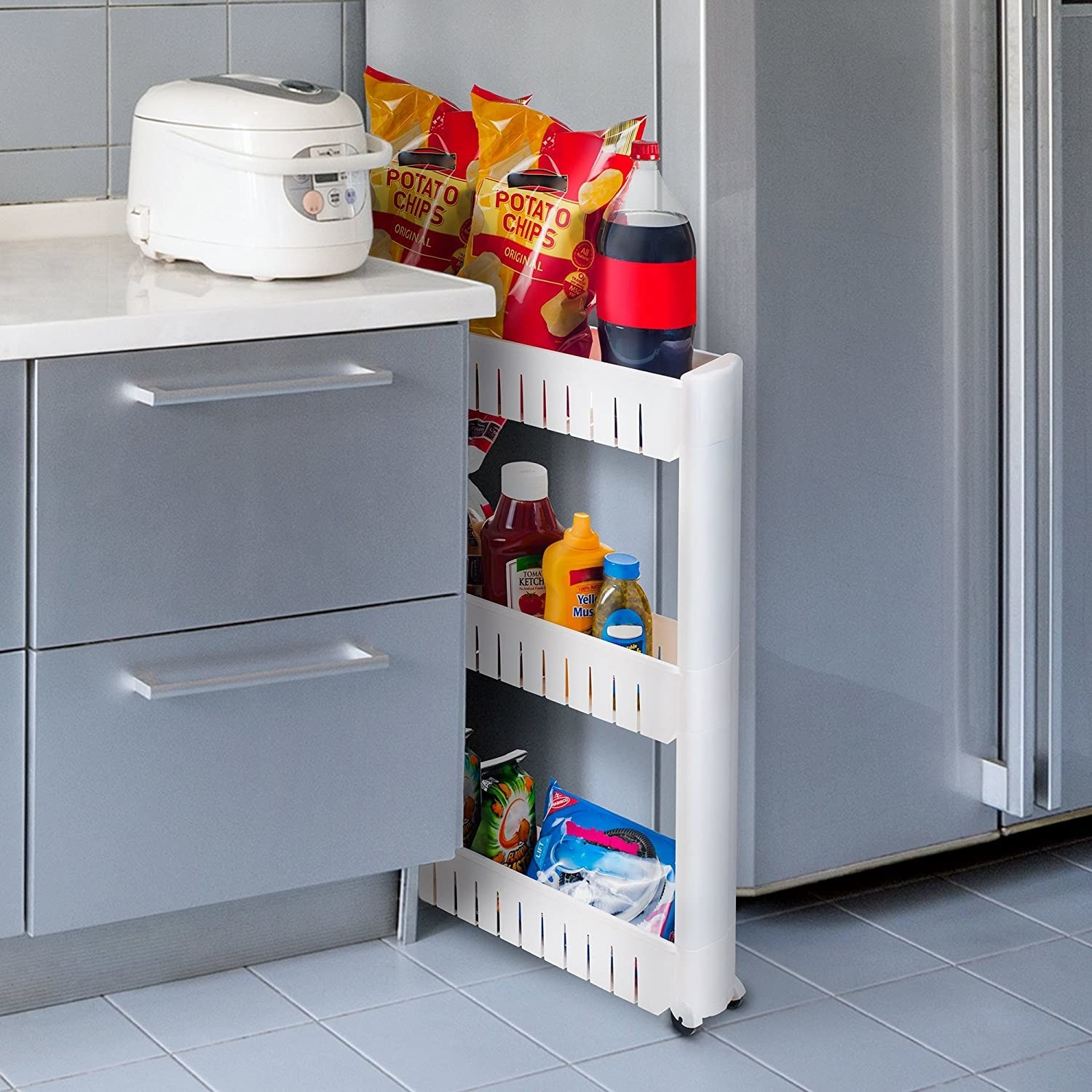 The three-tiered shelf between a counter and a fridge, stocked with snacks