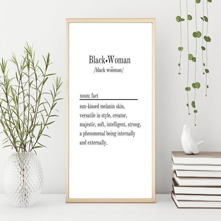 """Minimalist print with white background and black text that says """"Black Woman"""" in the style of a dictionary definition"""