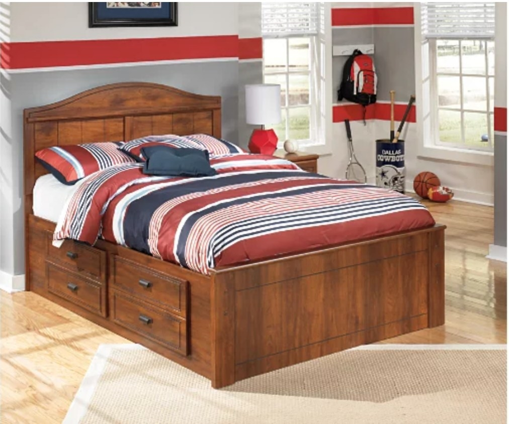 A kids, full-panel bed with 2 storage drawers
