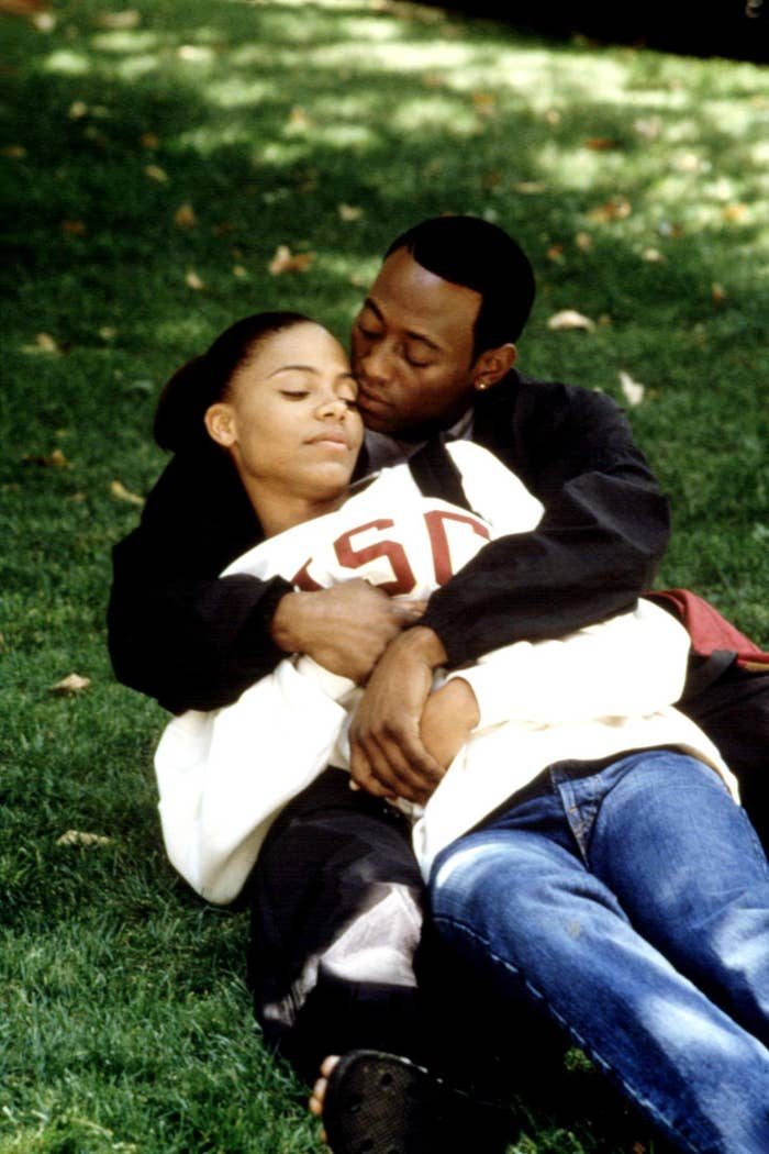 Sanaa Lathan and Omar Epps laying in the grass