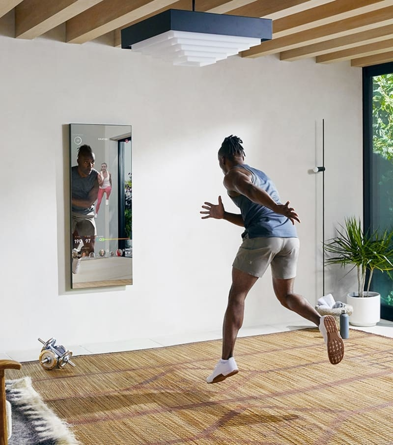 a model jogging in place in front of the Mirror
