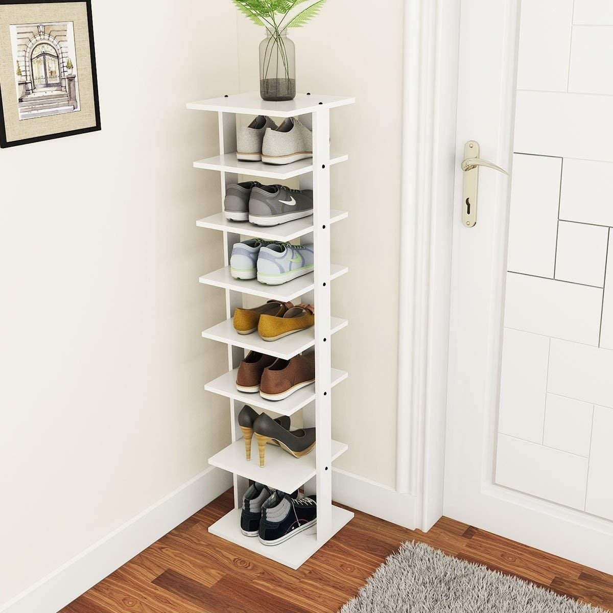 A seven tier simple white standing shoe rack