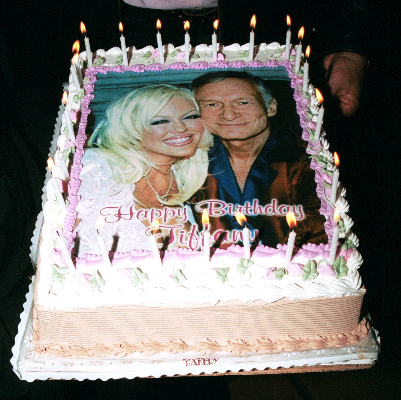 Hugh Heffner and a playmate's photos printed onto a birthday cake
