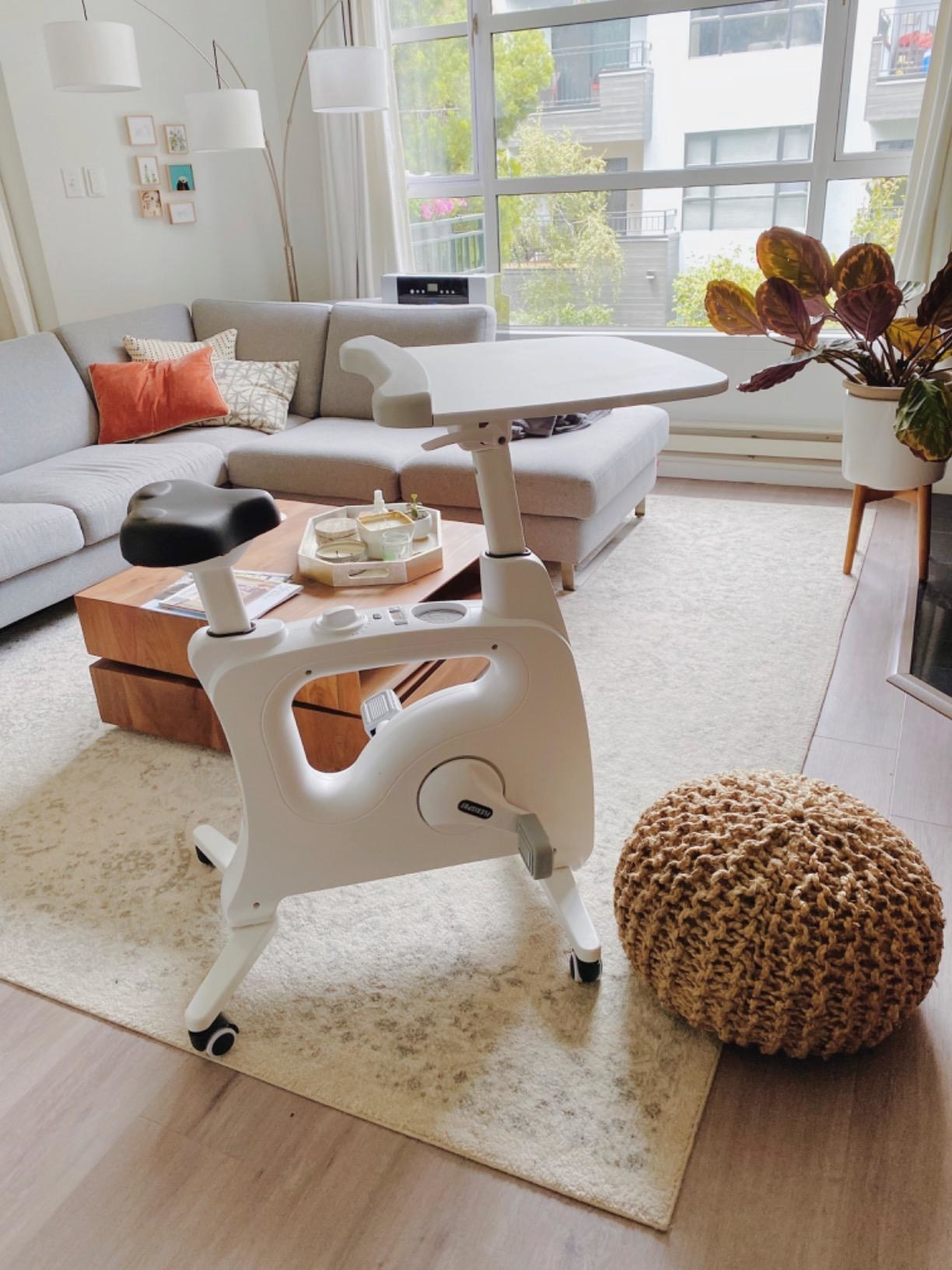 the white flexispot Adjustable Exercise Workstation in a living room