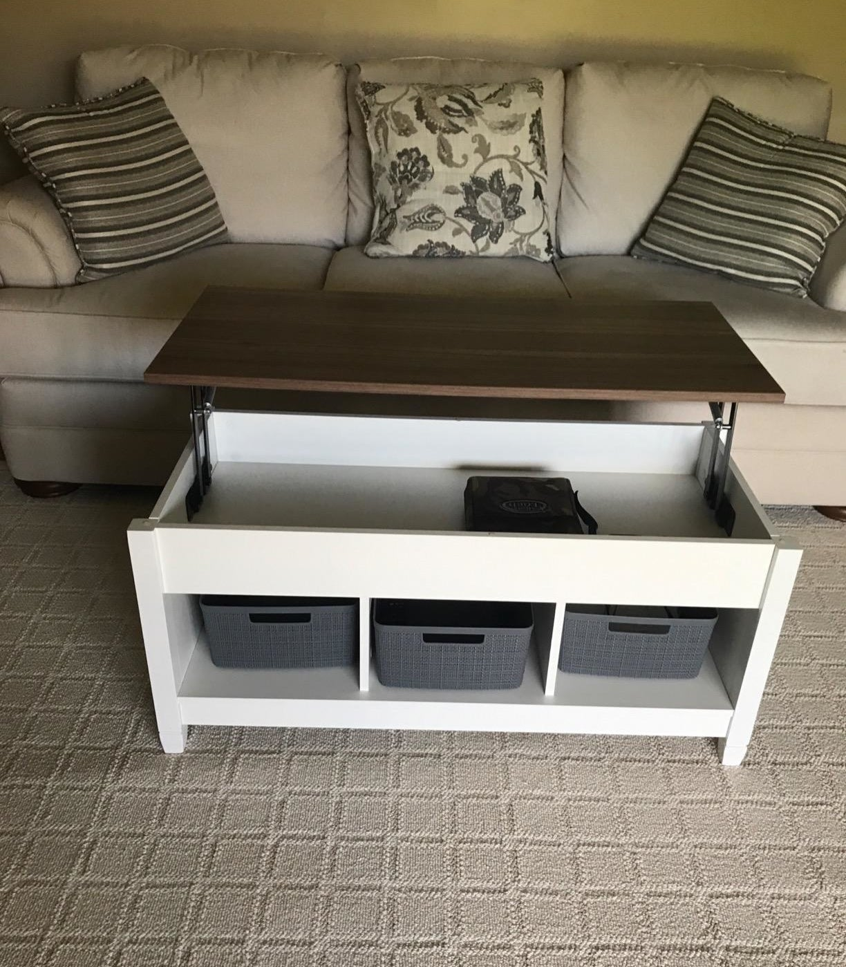 reviewer image of the white TANGKULA lift top Coffee Table in a living room with the top lifted up