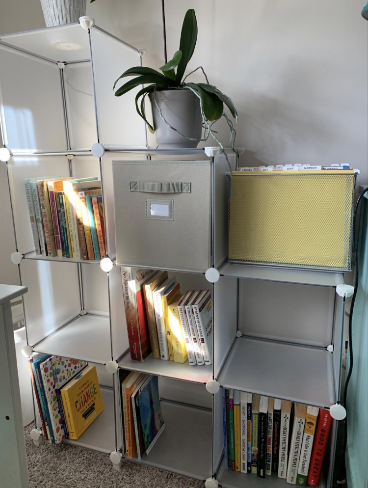 Reviewer image of clear box-shaped storage shelving tiered with two boxes, then three, then four