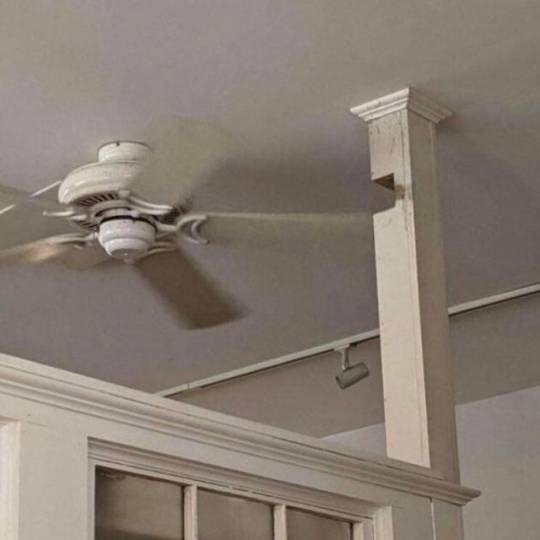 ceiling fan with a cutout in a beam so it can spin freely