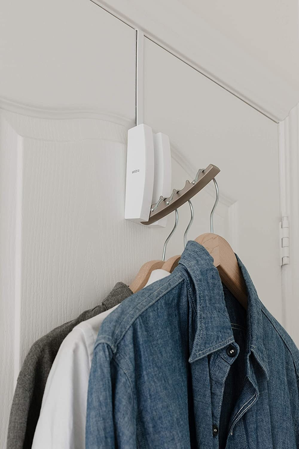 The over the door flip valet with grooves to hold hangers