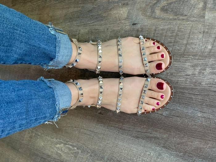 Reviewer's photo of sandals standing on floor