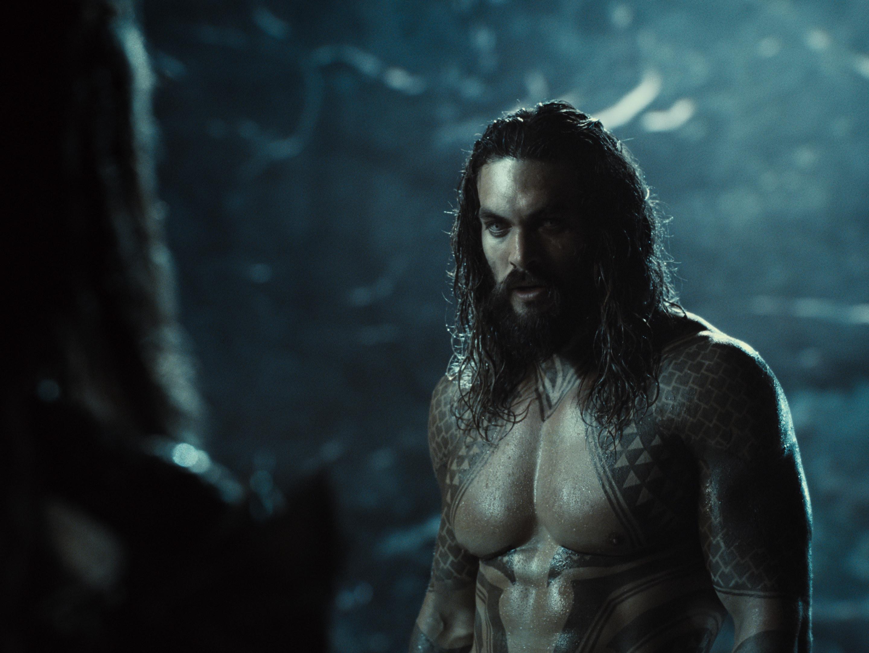 A shirtless Jason Momoa as Aquaman