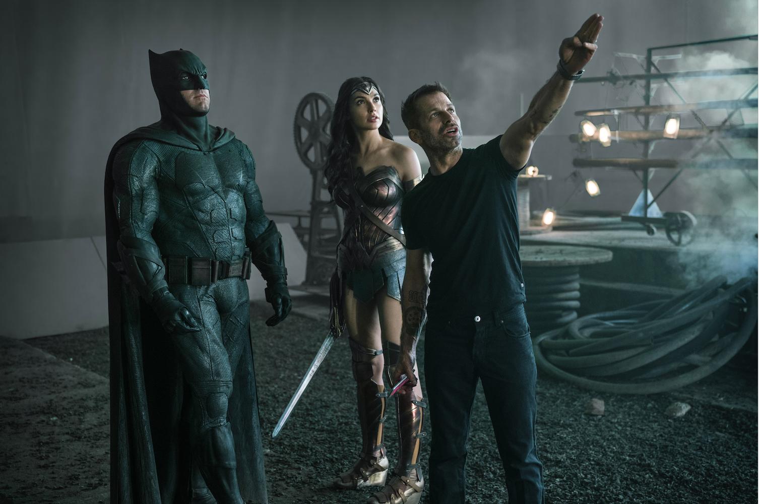 Zack directing Ben Affleck, who plays Batman, and Gal Gadot, who plays Wonder Woman, on set