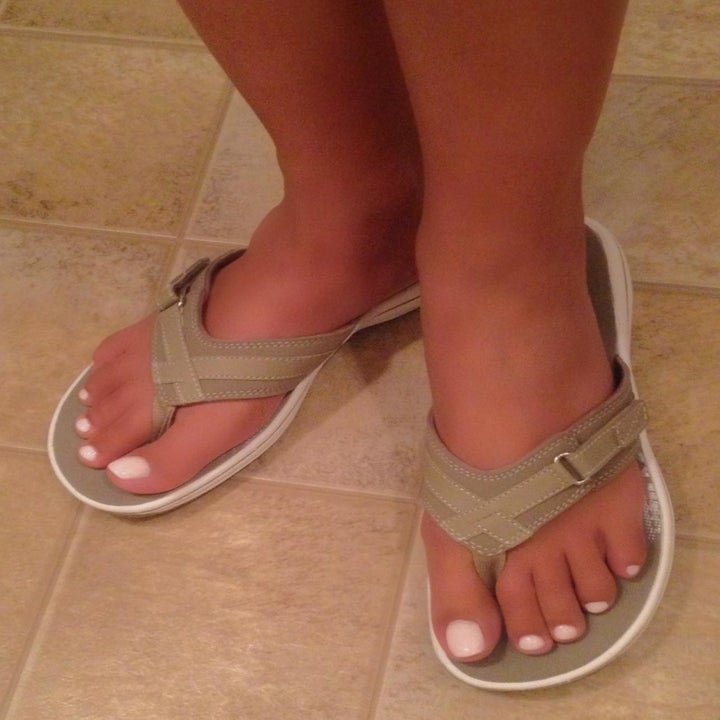a reviewer photo of someone wearing the flip-flops