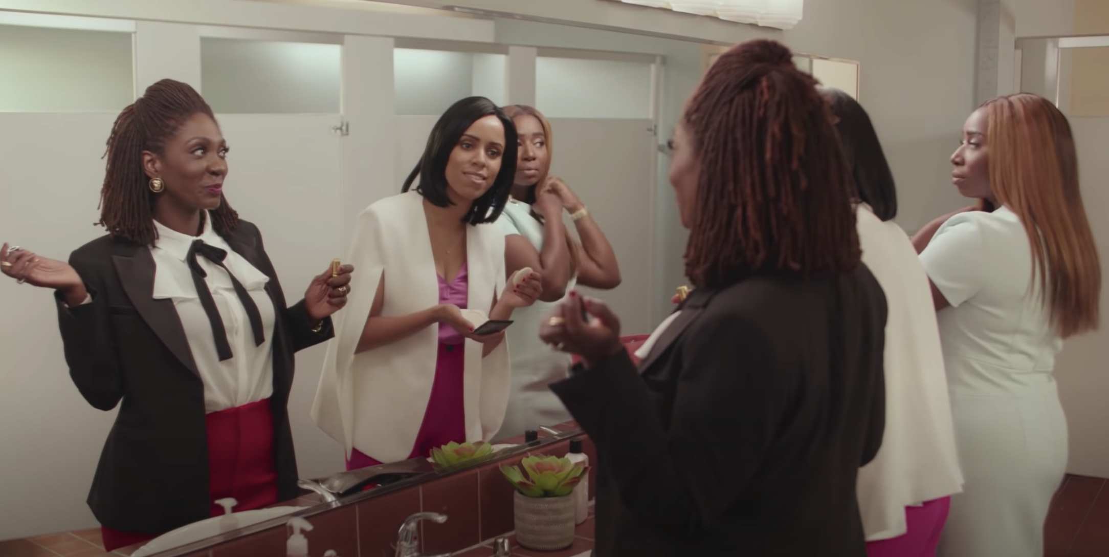 Three Black women discussing skincare during an Astronomy Club sketch