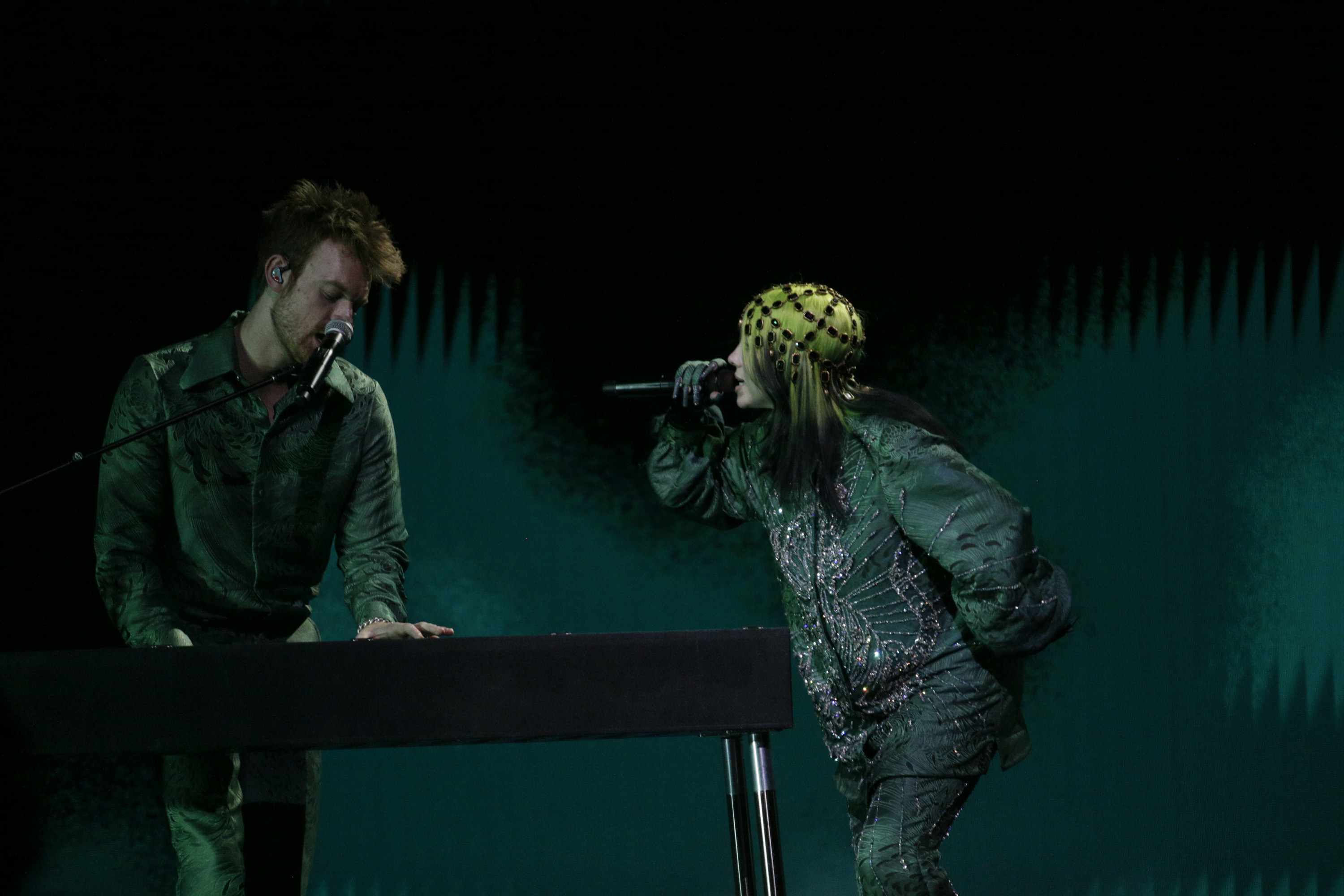 Billie wearing a bejeweled headpiece while performing at the Grammys