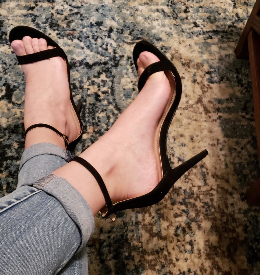 Reviewer's photo of heels on foot sitting down