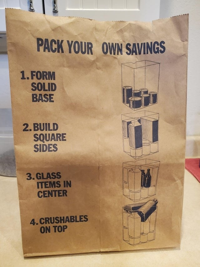 A paper grocery bag with instructions on how to pack it properly