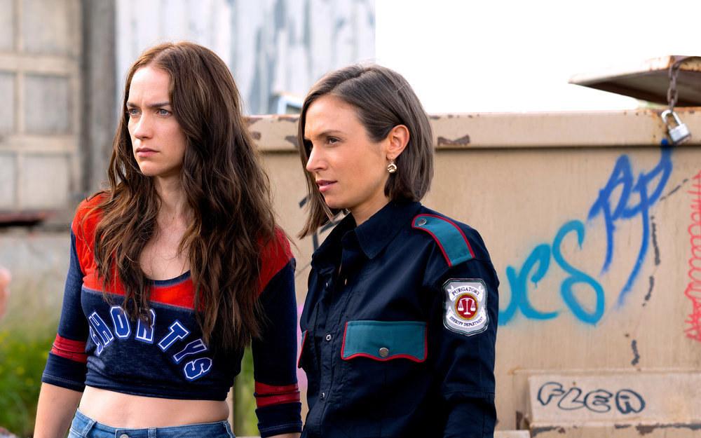 "Melanie Scrofano and Dominique Provost-Chalkley in ""Wynonna Earp"""