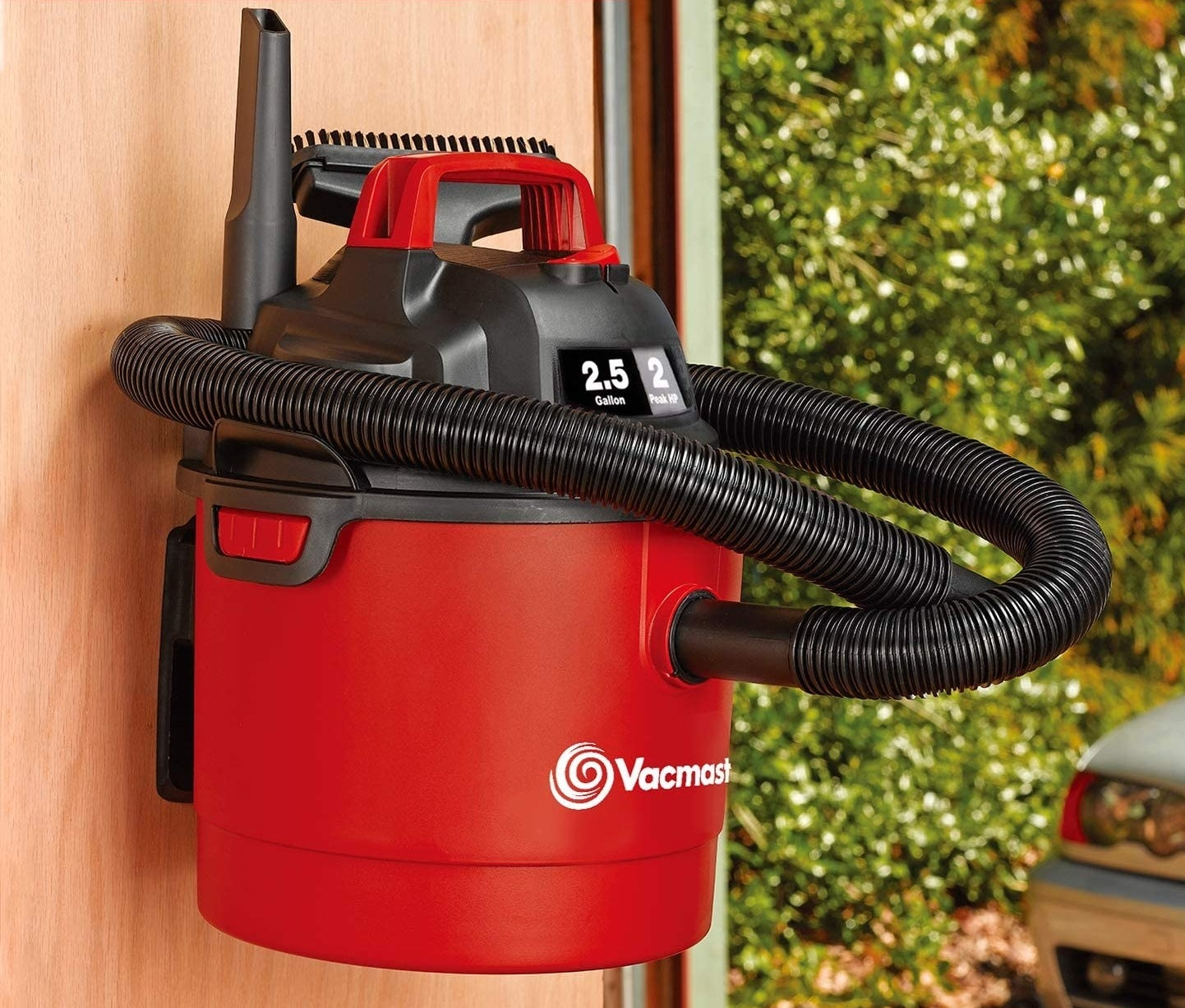 Lightweight red wet dry shop vac with black hose and wall mount