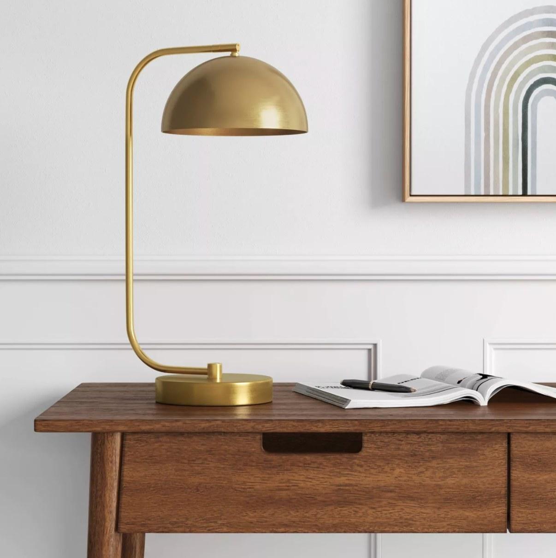 The brass desk lamp