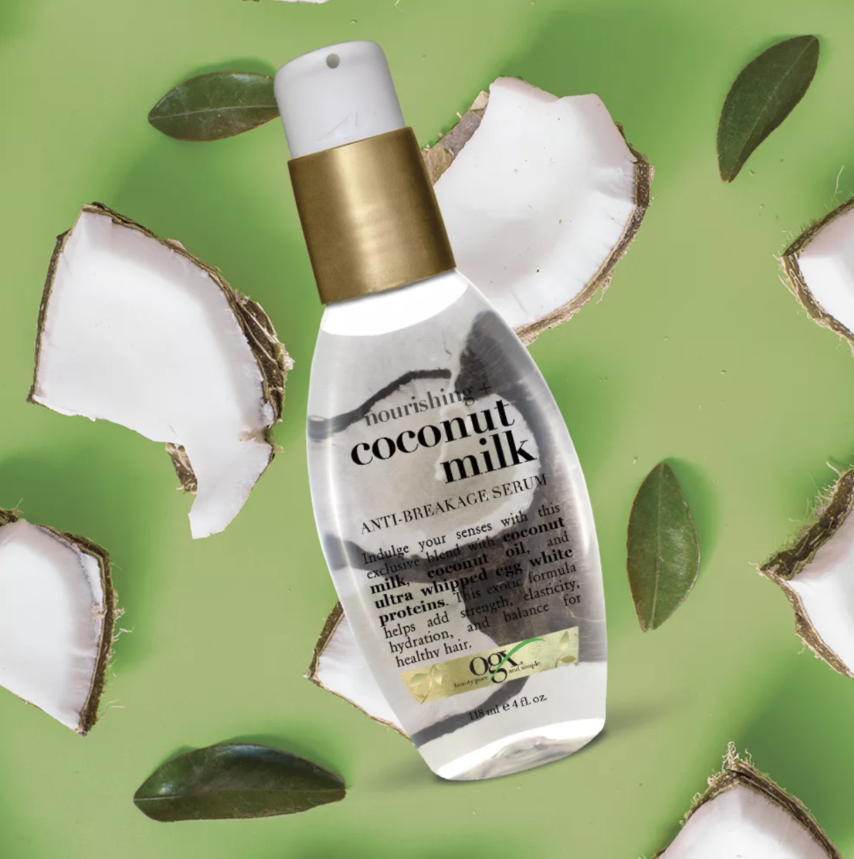 the serum in a clear bottle around crushed coconuts