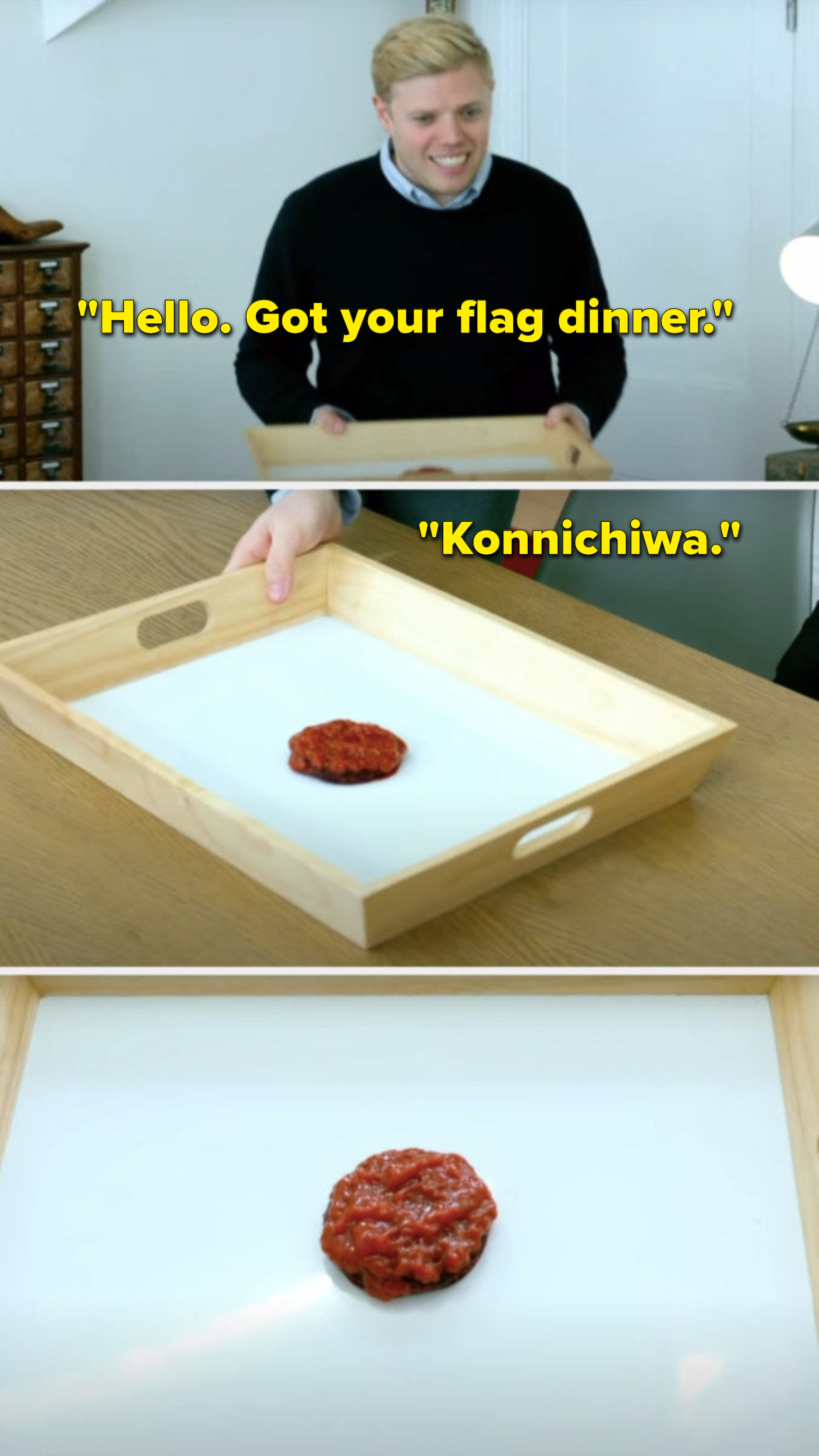 """Rob Beckett says, """"Hello, got your flag dinner, konnichiwa,"""" and we see his meal is a cracker in the middle of a piece of paper, meant to look like the Japanese flag"""
