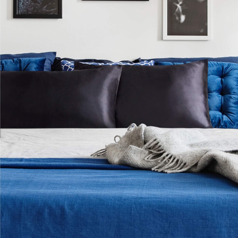 black satin pillowcases on bed