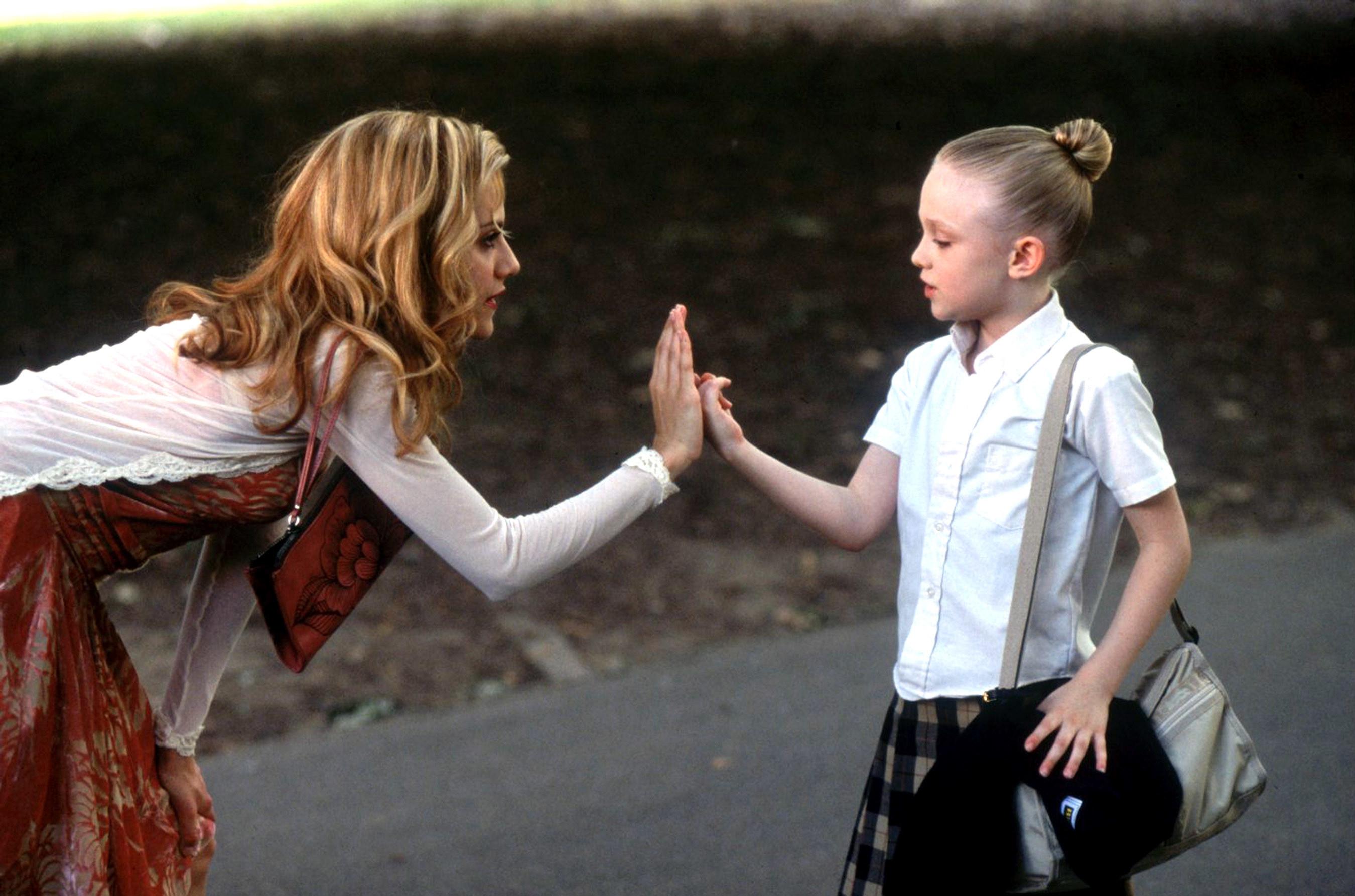 Brittany Murphy and Dakota Fanning in the movie uptown girls