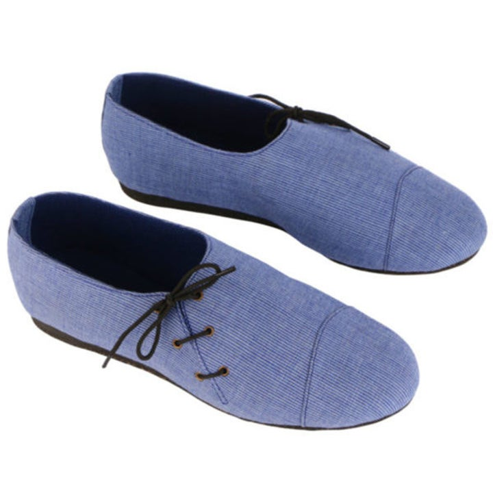 The cotton shoes with lace-up detailing along the side toe