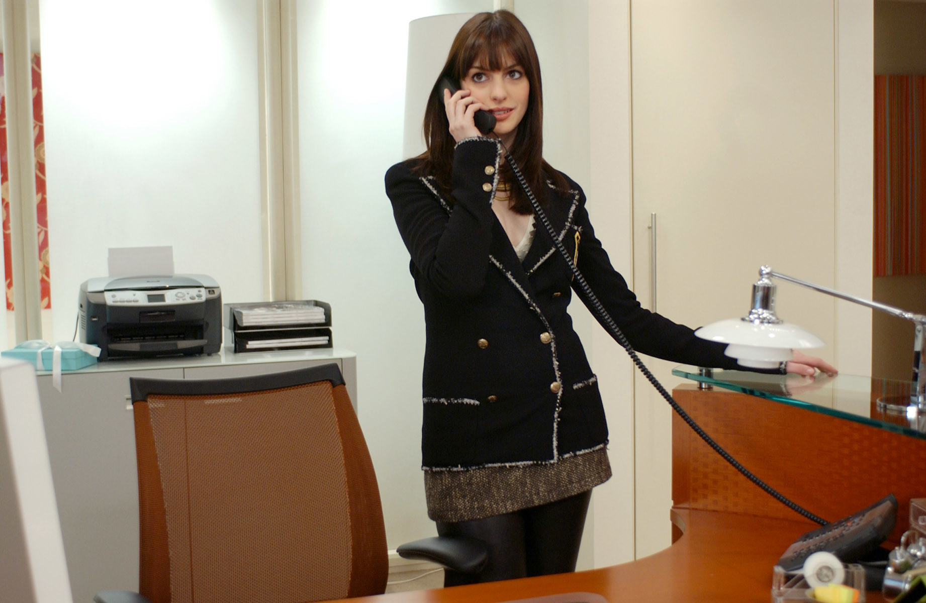 Anne in the Chanel answering a phone