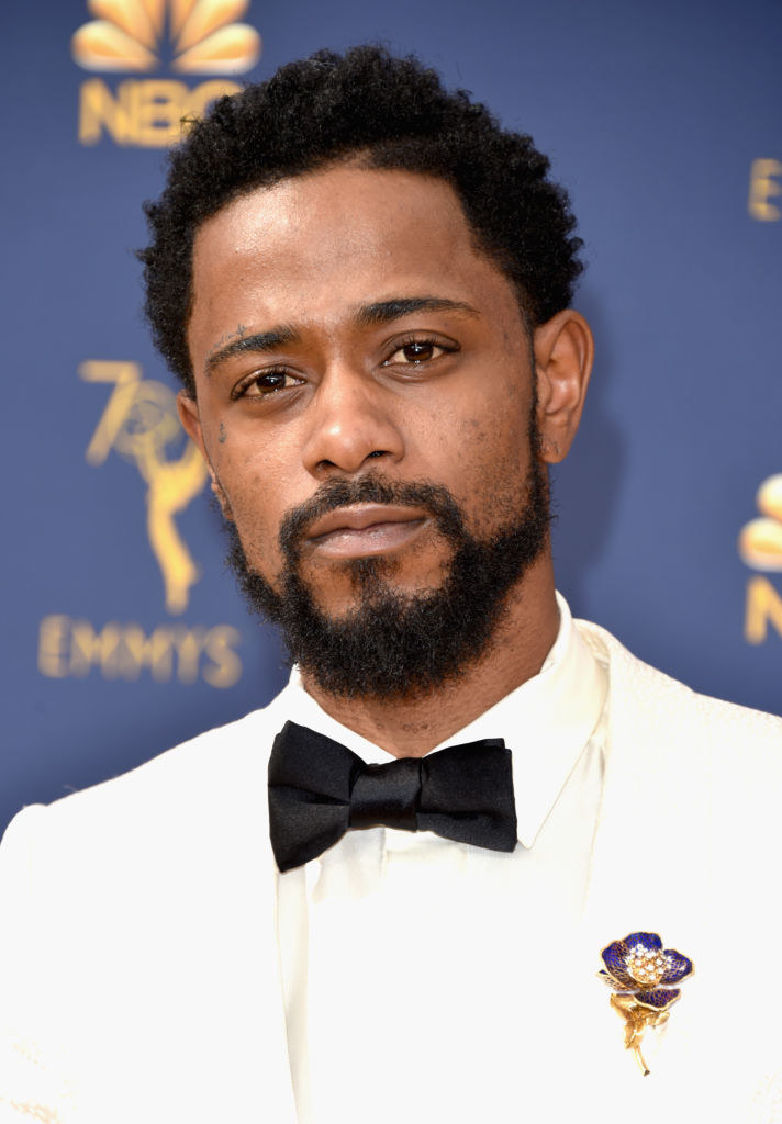 Lakeith Stanfield attends the 70th Emmy Awards at Microsoft Theater in a suit adorned with a jeweled flower brooch
