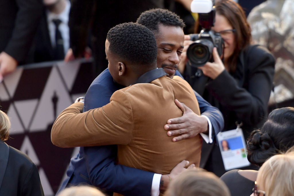 Lakeith Stanfield and Daniel Kaluuya hugging at the 90th Annual Academy Awards
