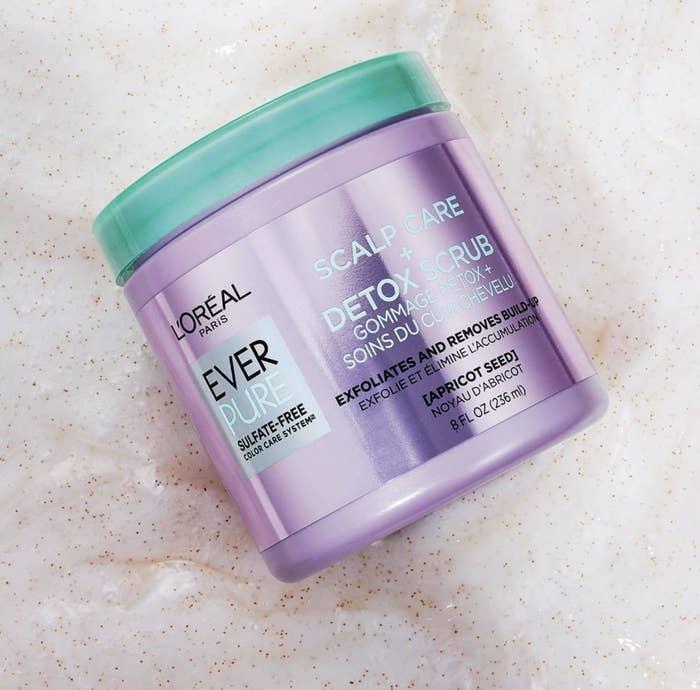 A purple jar with scalp scrub