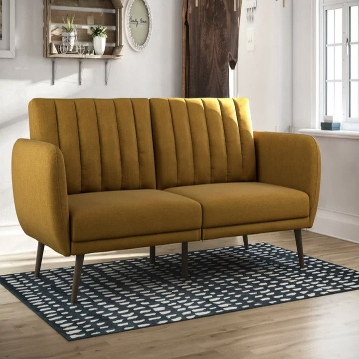 the couch in mustard