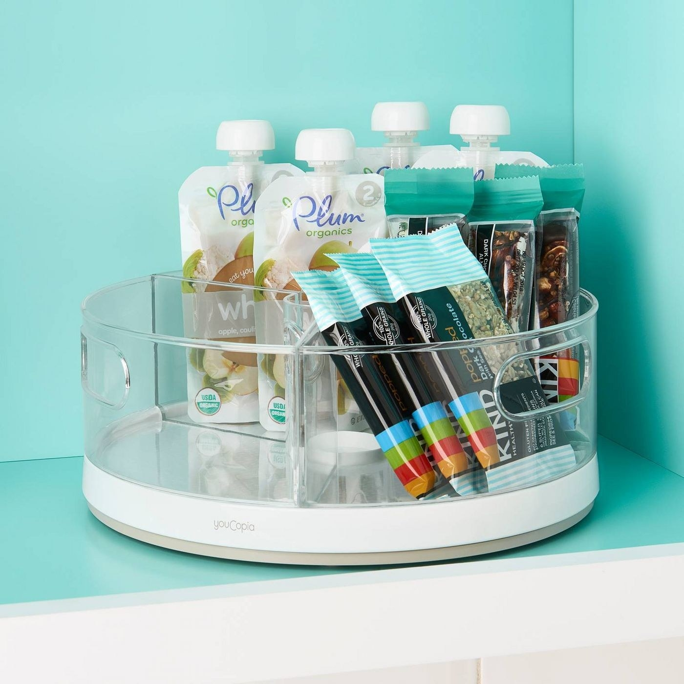 clear plastic turntable with different bins holding snacks