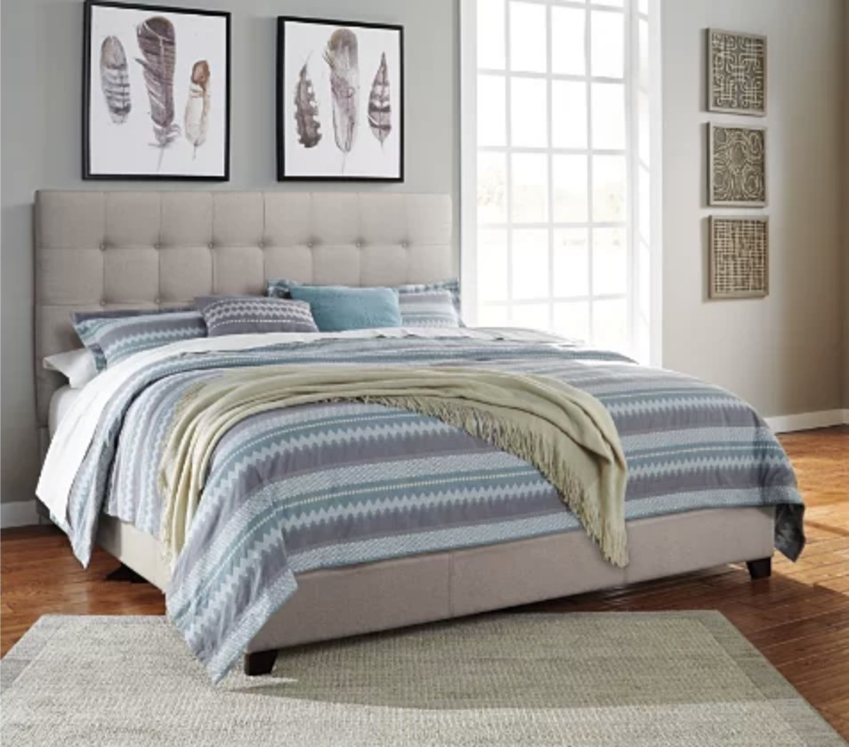 An upholstered queen bed