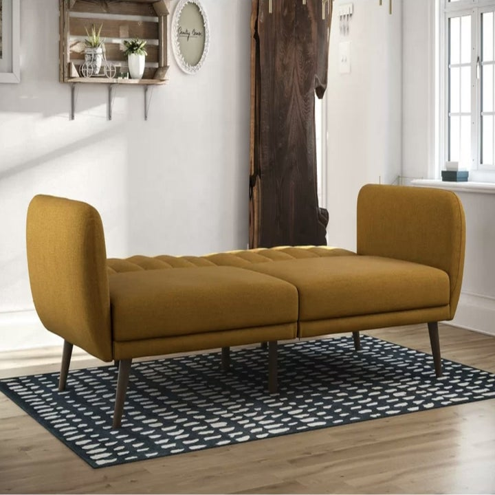 the couch in mustard as a bed