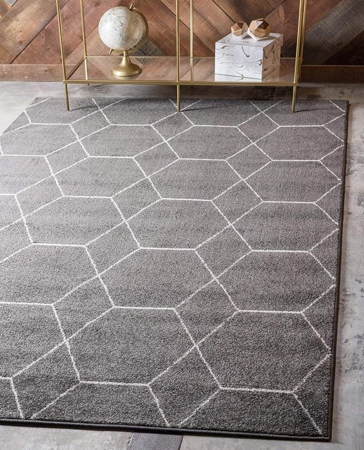 Gray area rug with white geometric design