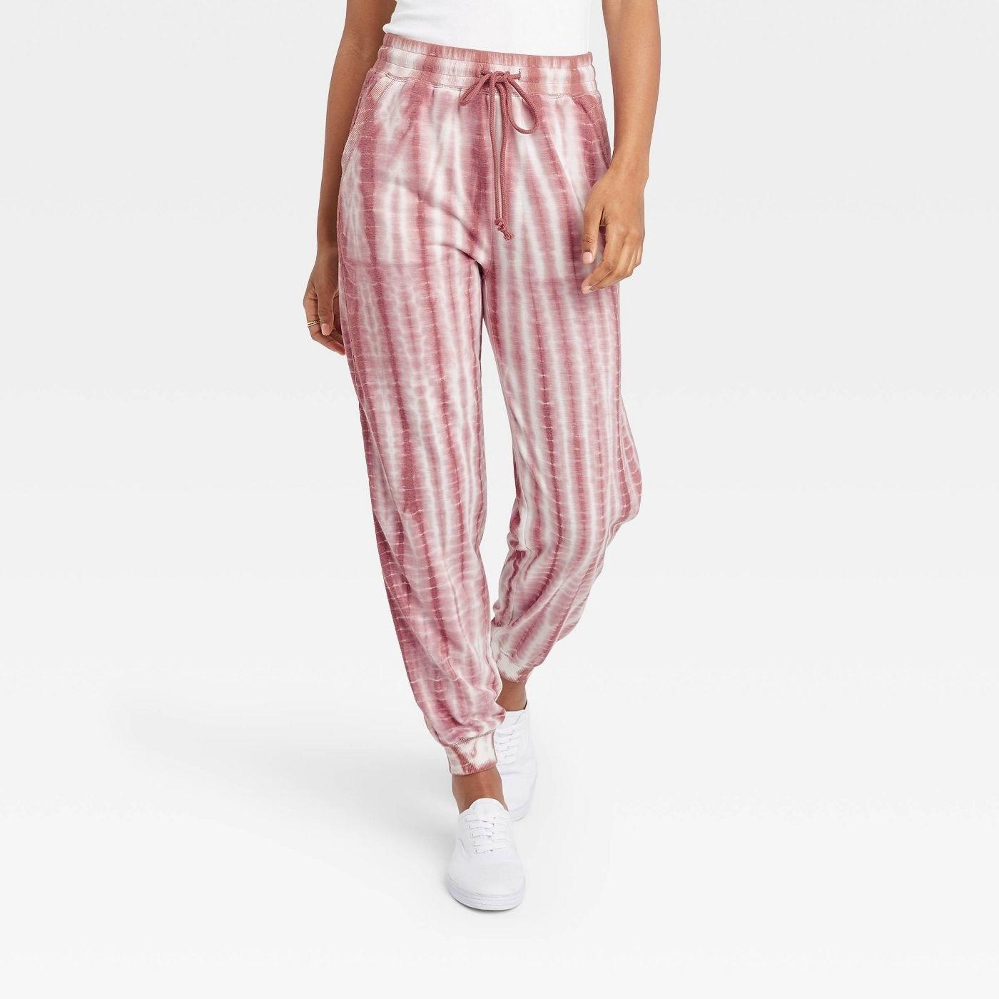 Model in tie dye jogger pants