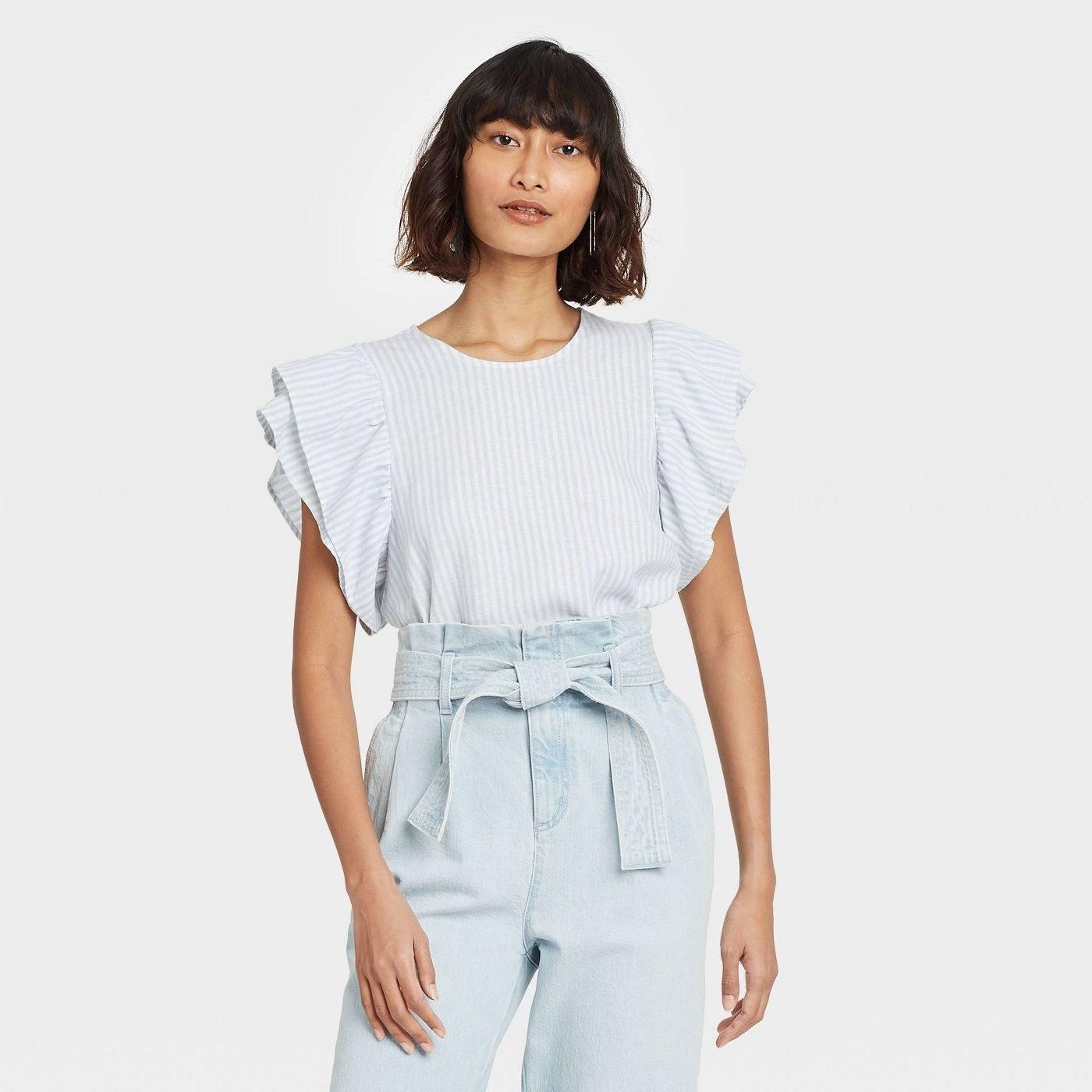 Model in ruffle short sleeve linen top