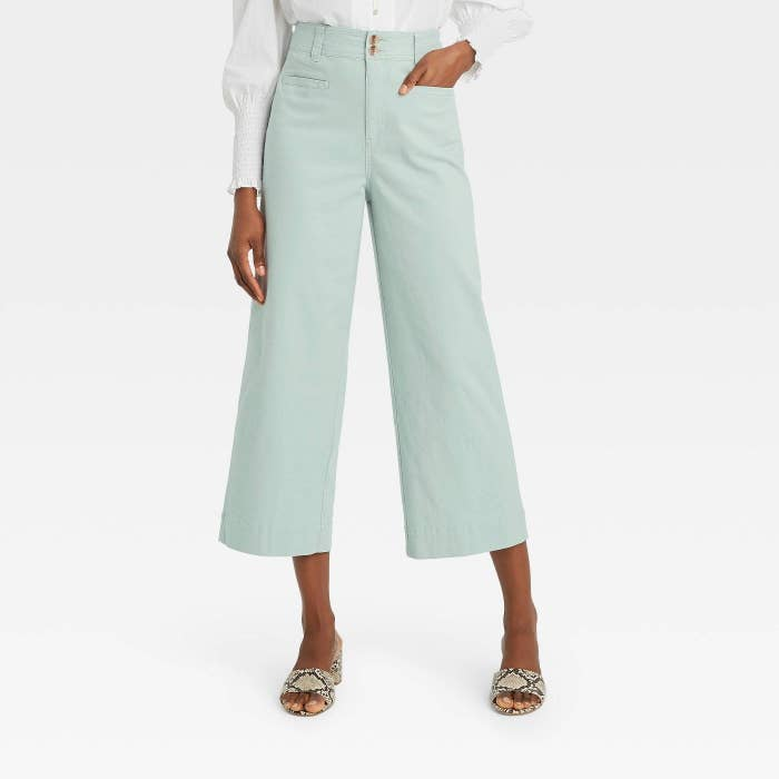 Model in cropped wide leg pants