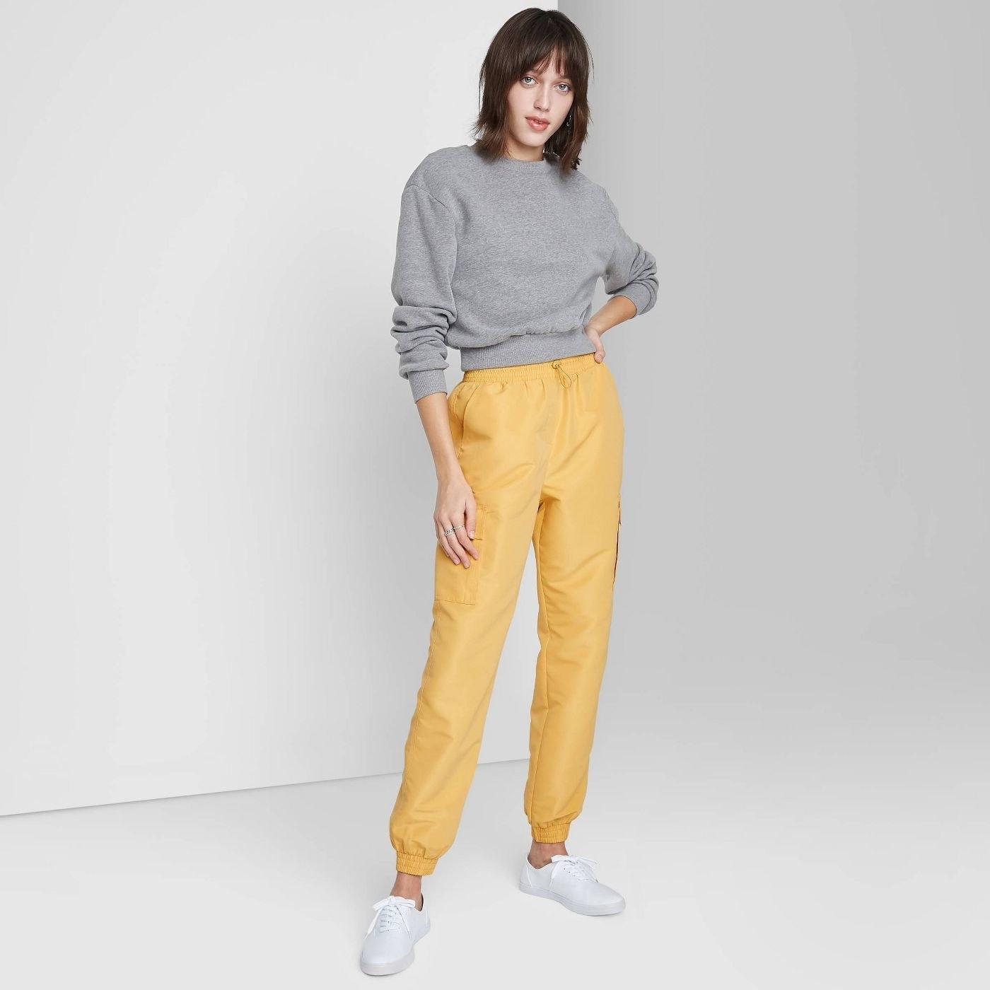 Model in cargo jogger pants