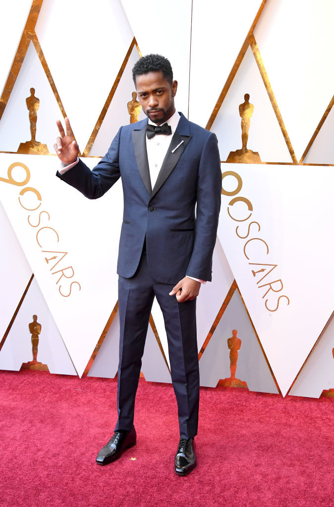 Lakeith Stanfield giving the peace sign on the red carpet of the 90th Annual Academy Awards at Hollywood & Highland Center