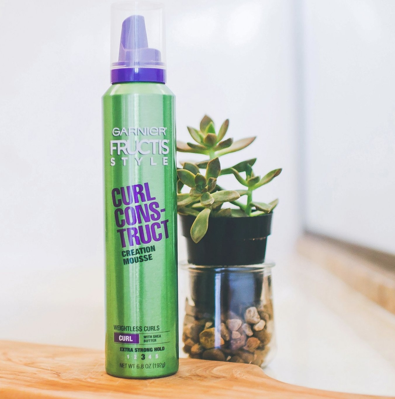 A green can of hair mousse
