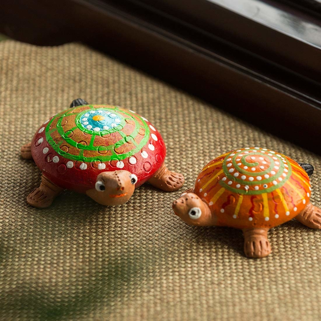 Two handpainted turtles on a table