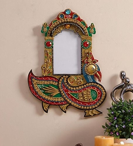 A handpainted photo frame on the wall