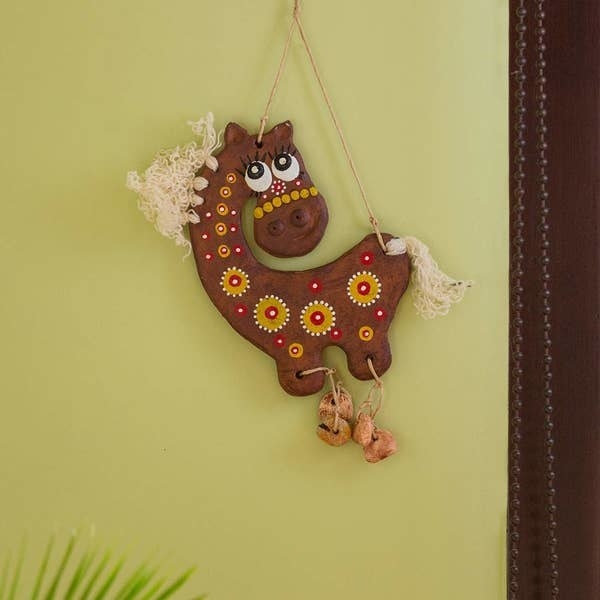 A terracotta horse wall-hanging
